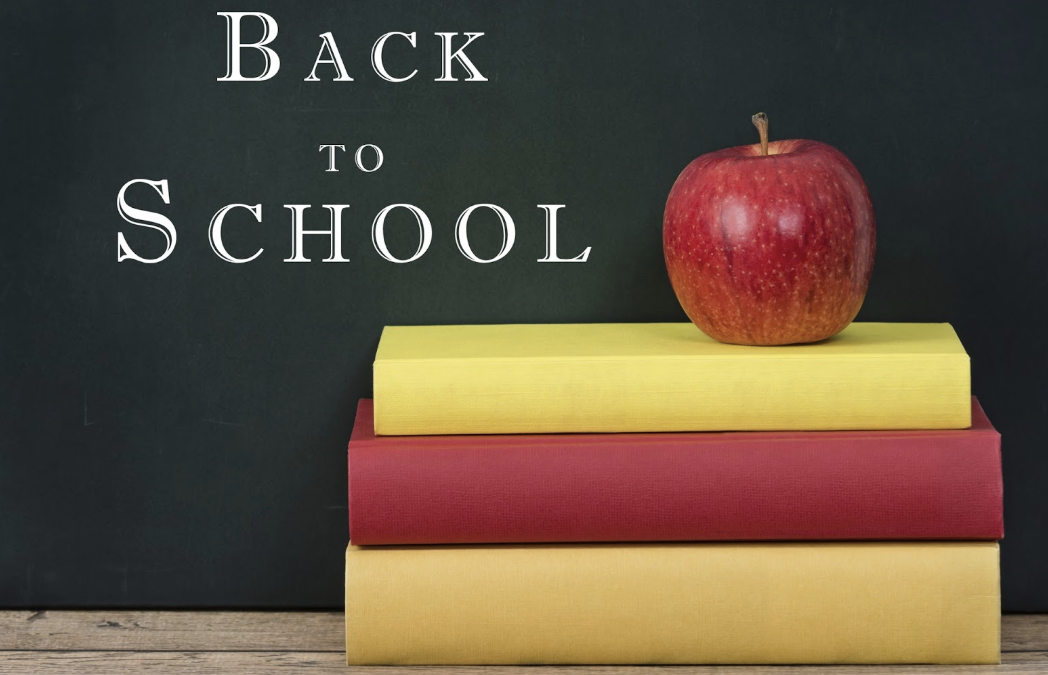 Blackboard with books and an apple back to school