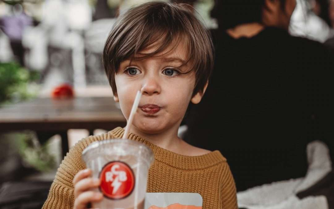 boy with soda - childhood obesity