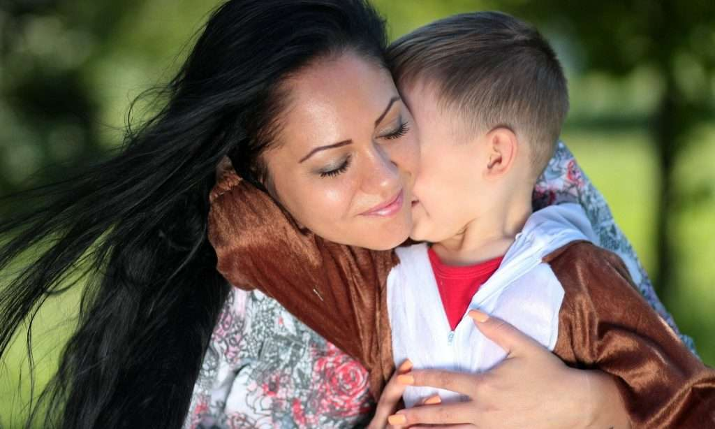Mom and son hugging